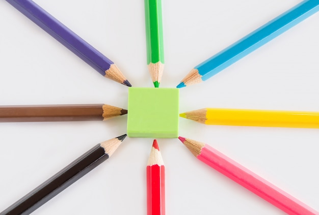 Group of graphite and color pencil, green rubber on white background with space copy