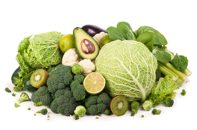 Group of green vegetables and fruits on white