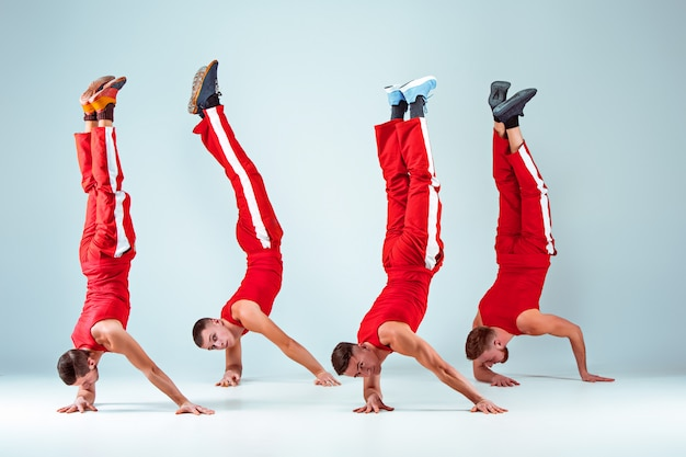 Group of gymnastic acrobatic caucasian men on balance pose