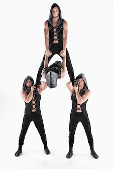 Group of gymnastic acrobatic caucasian men on balance pose
