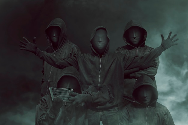 Group of hacker with mask in hoodies