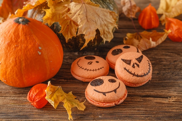 Group of halloween mini pumpkin shaped pies, overhead scene on rustic wood table