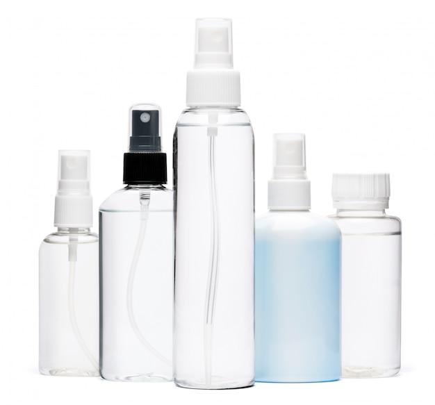 Group of hand sanitizer spray bottles isolated on white background
