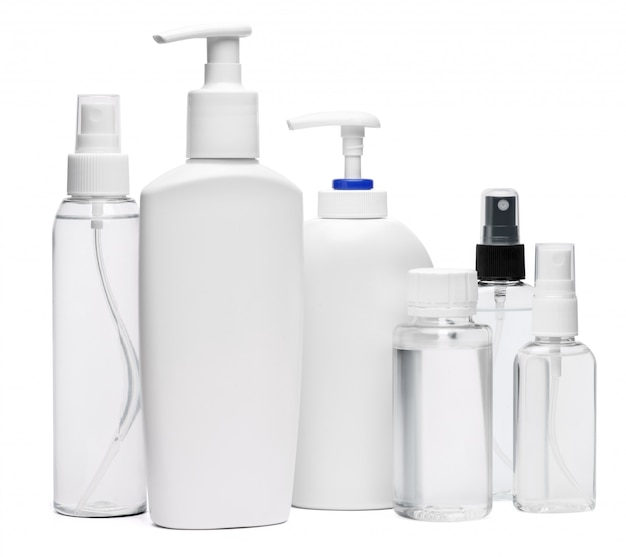 Group of hand sanitizer spray and liquid soap bottles isolated on white background