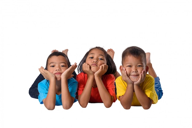 Group of happy asian children lying on floor isolated white background