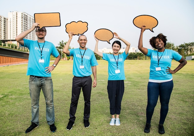 Group of happy and diverse volunteers with speech bubbles