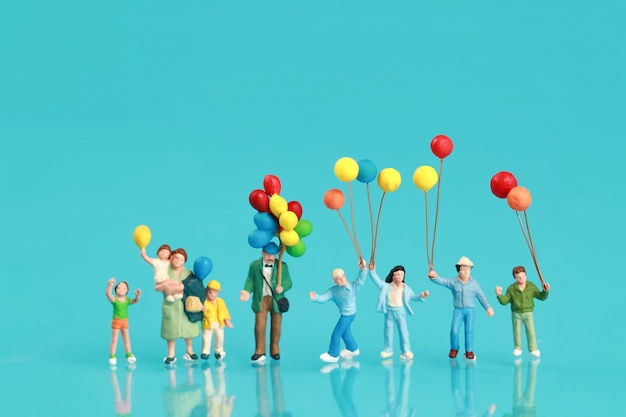 A group of happy family are having fun and holding balloon