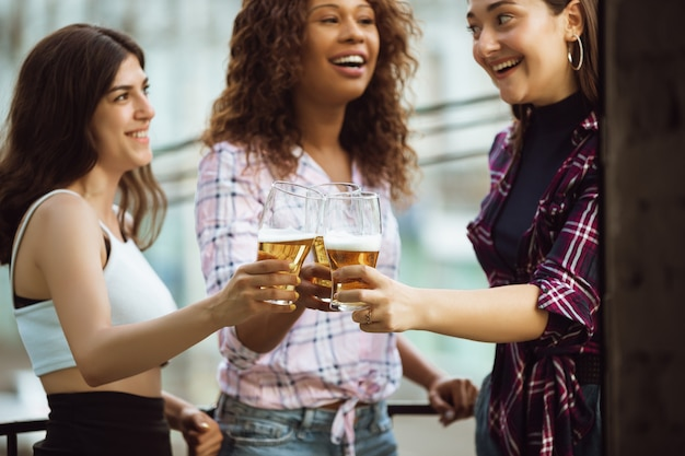 Group of happy friends having beer party in summer day
