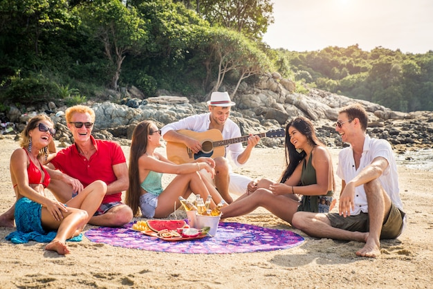 Group of happy friends on a tropical island