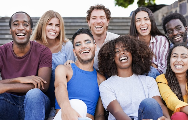 Group of happy multiracial people smiling on camera - friendship and diversity concept