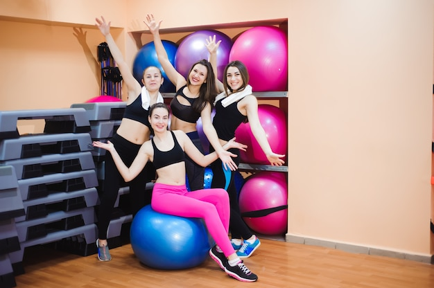 Group happy women trained in the gym using the equipment. group portrait