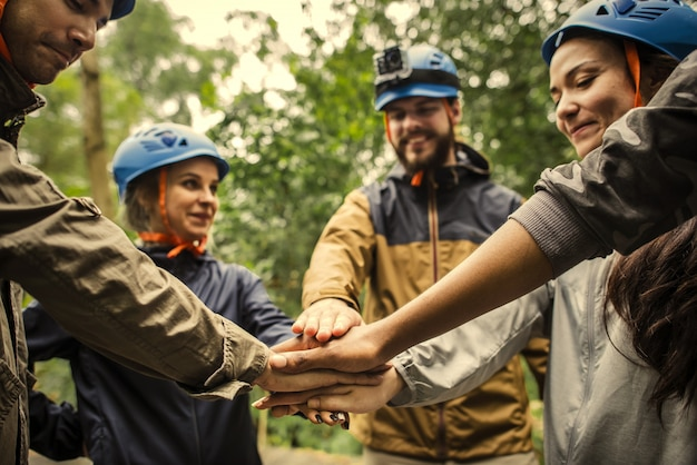 Group of hikers stacking hands