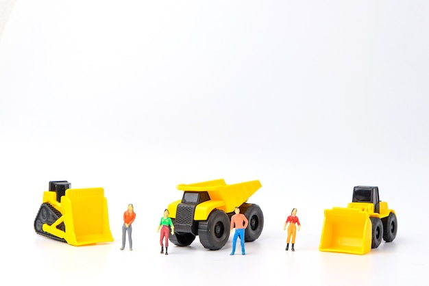 Group of human toy and heavy duty machinery