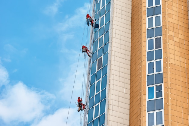 Group of industrial climber work on a modern building outdoor