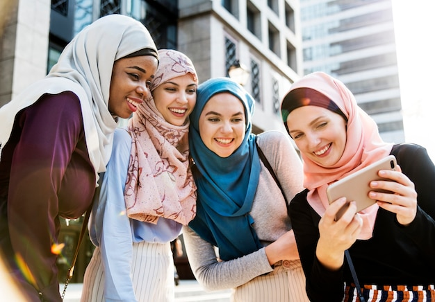 Group of islamic women taking selfie together