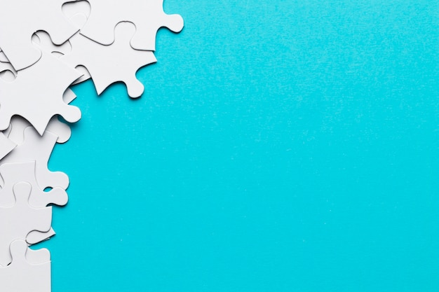 Group of jigsaw puzzle pieces with copy space backdrop