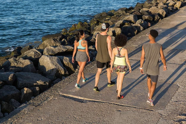 Group of joggers talking during workout