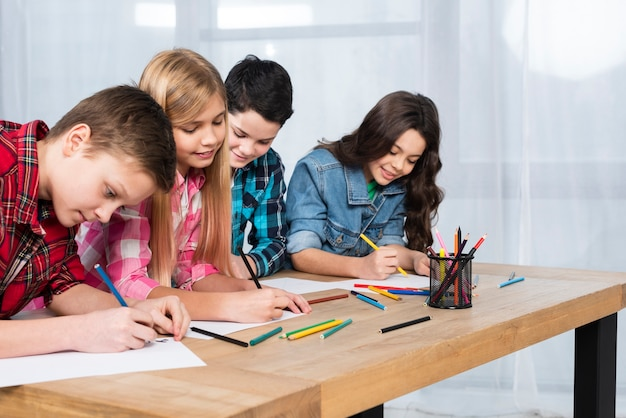 Group of kids coloring