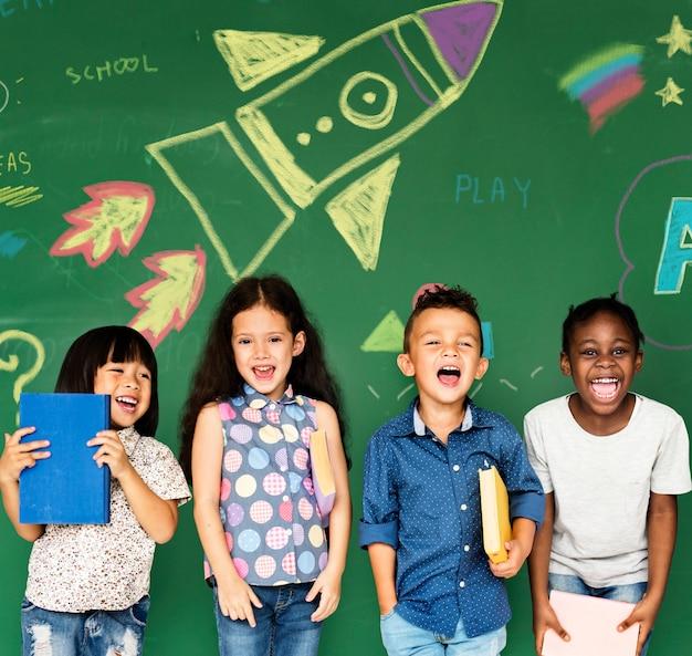Group of kids in front of blackboard