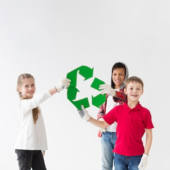 Group of kids happy to recycle together