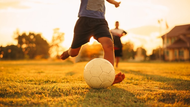 Group of kids playing soccer football