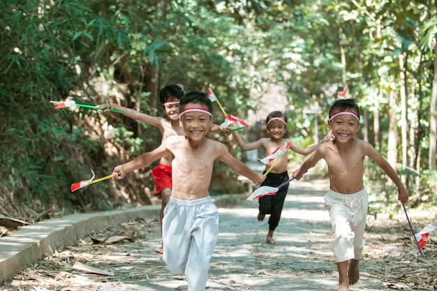 Group of kids running without clothes when holding flags