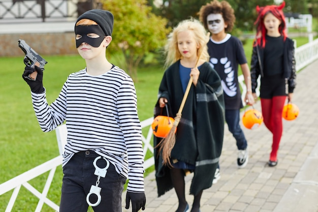 Group of kids trick or treating on halloween