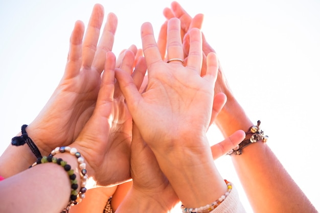 Group of many caucasian hands people together touching - cooperation and team people concept