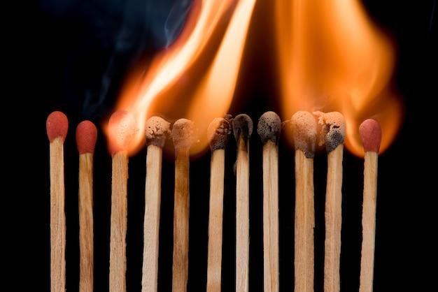 Group of match burn spread fire on black wall disease