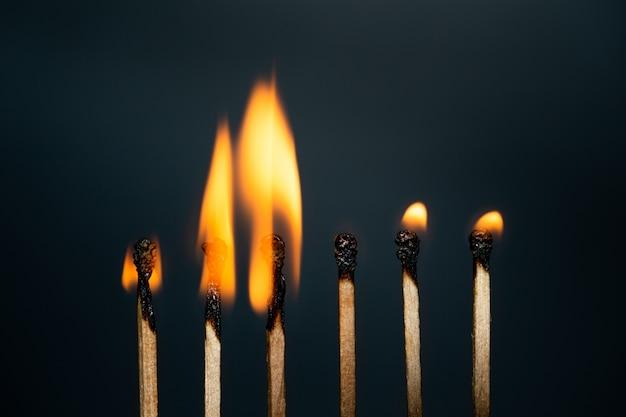 Group match burning on black