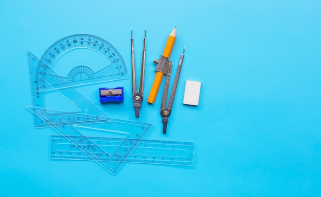 Group of mathematics geometry tools on blue background.