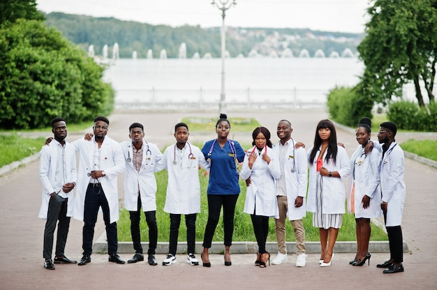 Group of medical students posed outdoor in white lab coats