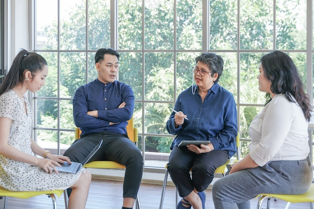 Group of mental health by psychologist consultant asian people meeting together to talk problem
