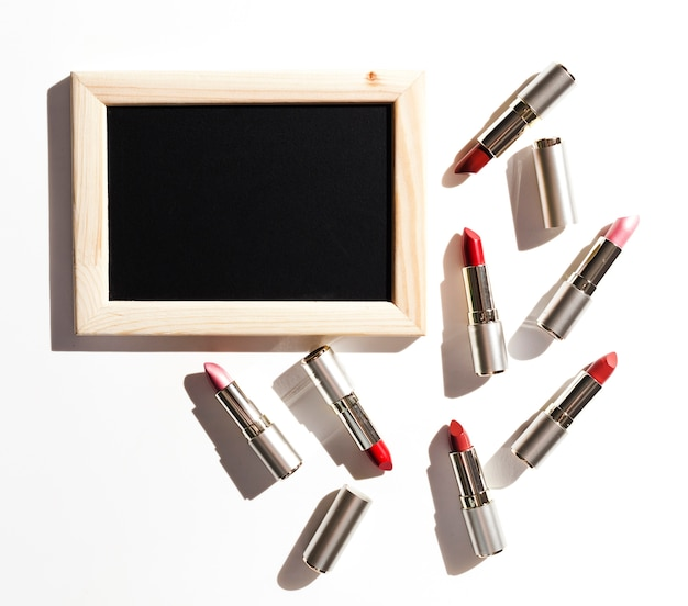 Group of metallic lipsticks with blackboard