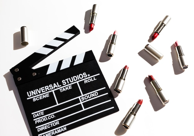 Group of metallic lipsticks with clapperboard