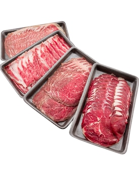 Group of mix raw beef. sliced raw beef place in a row on a black plastic tray isolated on a white background. sliced meat for cooking, fresh meat for grilling, yakiniku, sukiyaki or shabu.