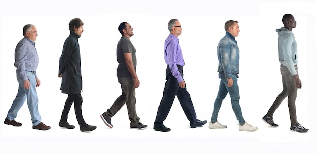 Group of mixed people walking on white