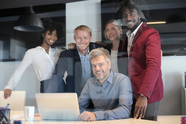 Group of multiethnic business partners having a creative business team meeting in a modern office