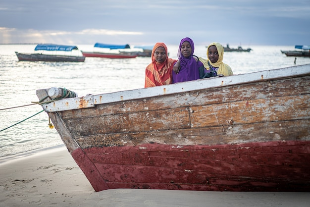 Group of muslim girls together on the beach