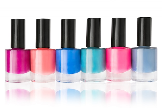 Group of nail polishes in a row isolated on white background