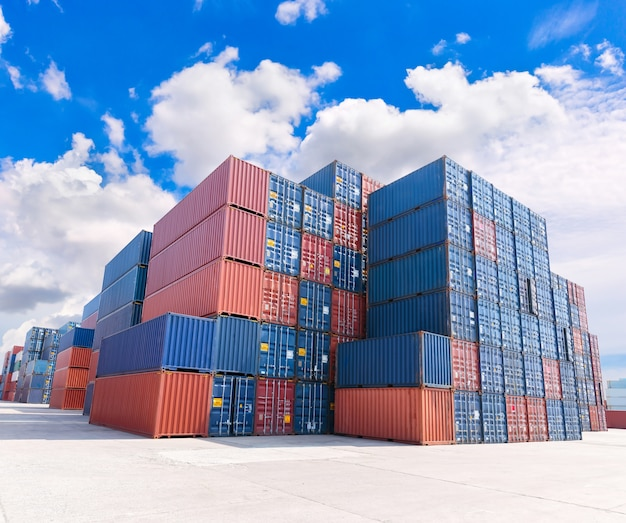 Group of numerous shipping containers in port  with blue sky