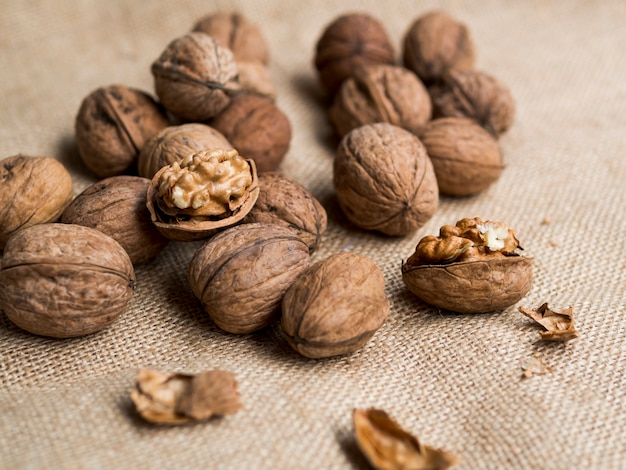 Group of nuts on brown background