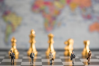 Group of businessmen walking in the chess board