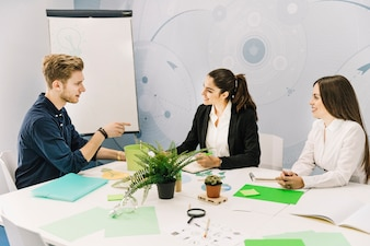 Group of businesspeople having conversation in office