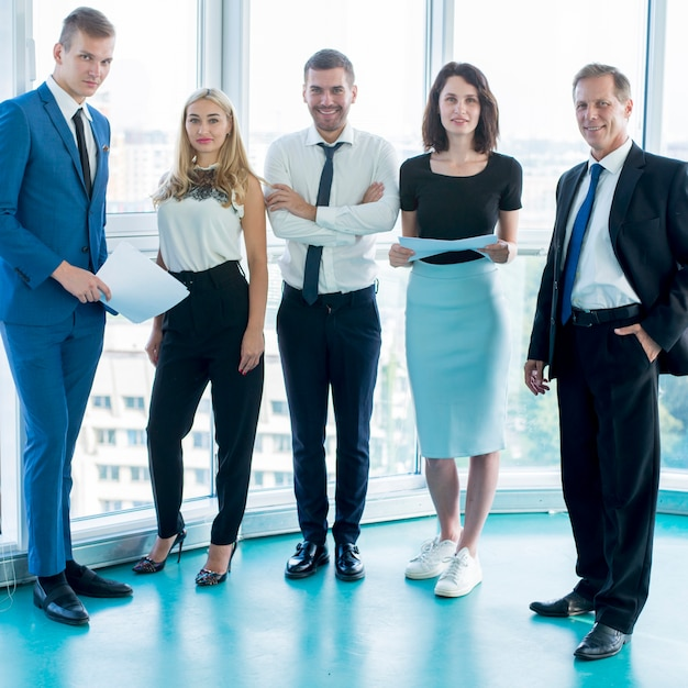 Group of confident businesspeople standing in office