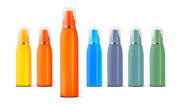 흰색 배경에 분리된 화장품 스프레이 병의 그룹입니다.
