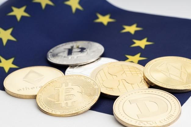 Группа крипто-монет на флаге европейского союза. криптовалюта в европе