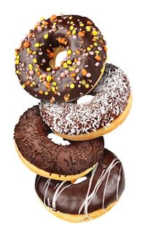 さまざまなチョコレート落下ドーナツのグループ