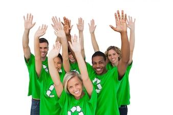 Group of environmental activists raising arms