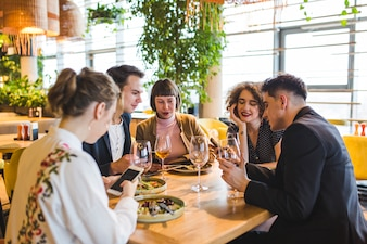 Group of friends eating in restaurant